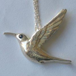 Sunbird pendant & sapphire in silver plate