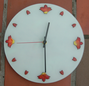 Fire clock in copper with sifted vitreous enamel mounted on sand-blasted glass