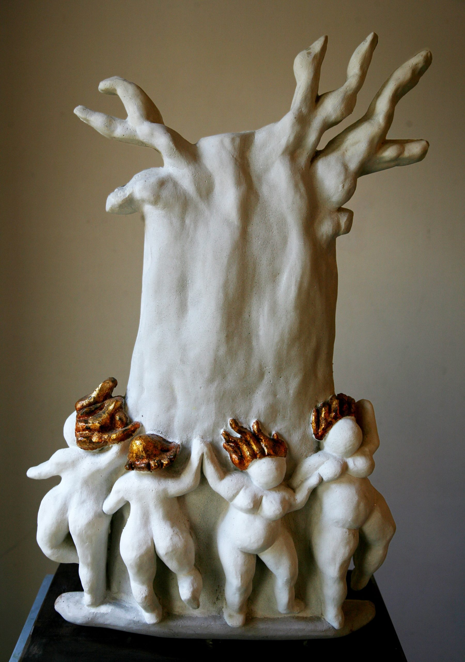 Nude women dancing around baobab tree