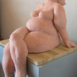 Cross-legged nude woman