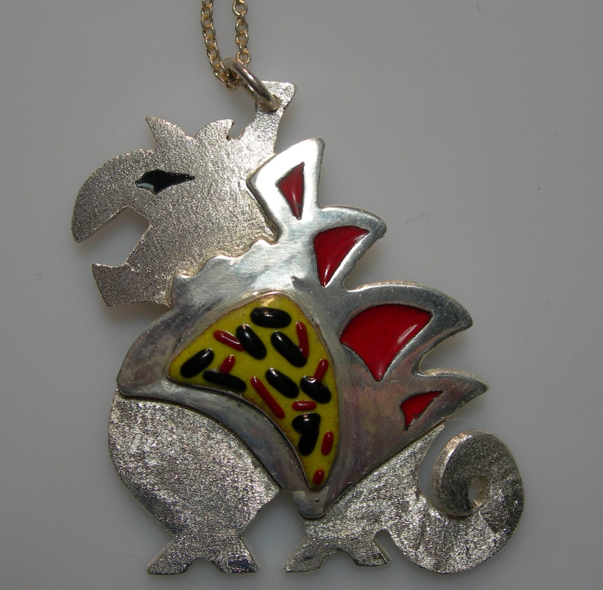 Fierce boy pendant in plated silver