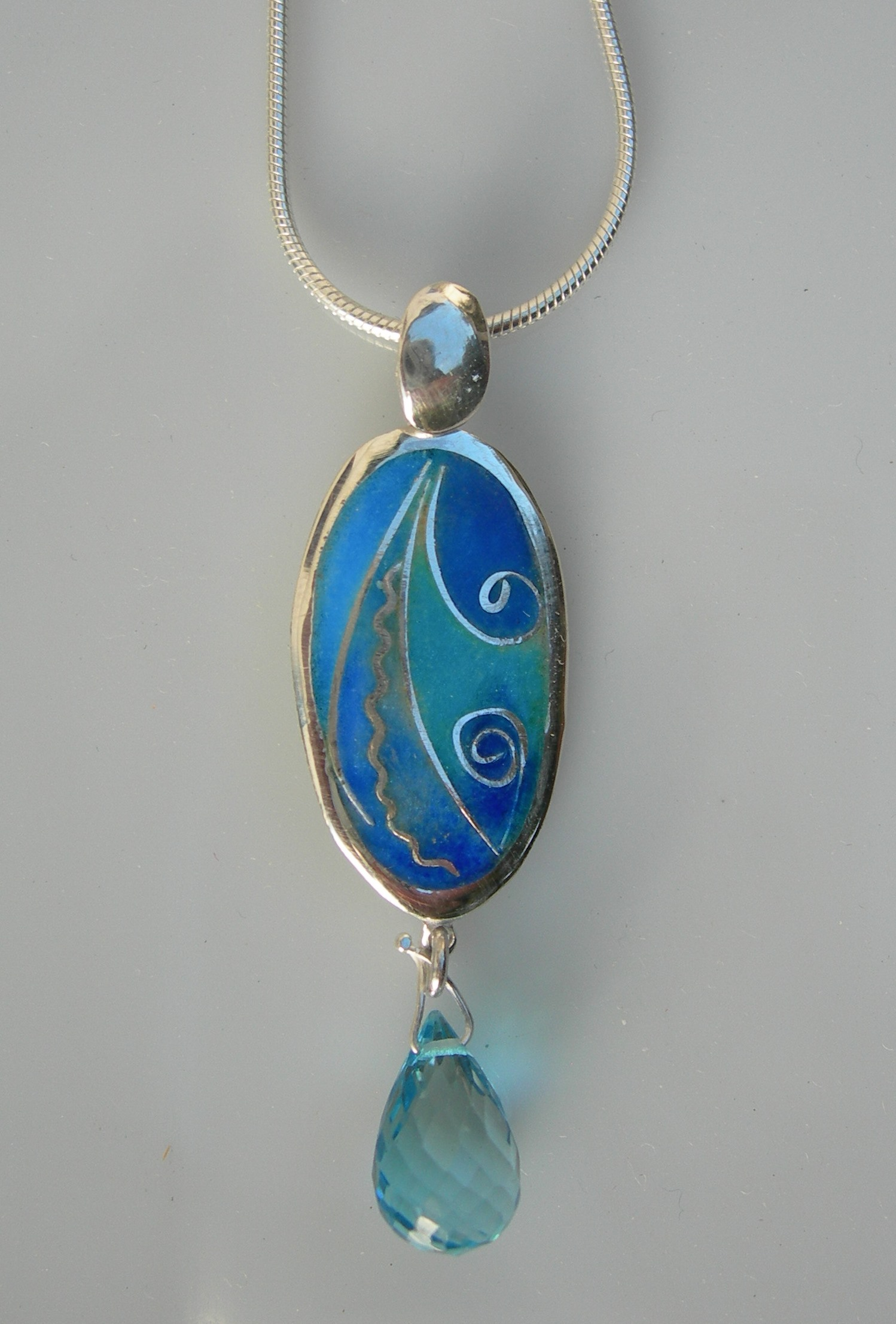 Blue oval pendant in sterling silver